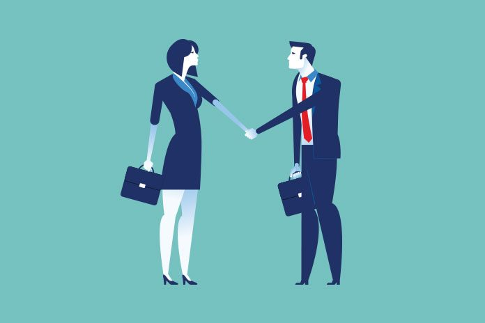 man and woman shaking hands to show How to find a graduate job in pharma