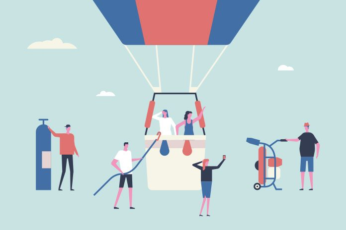 Image of people around a hot air balloon to show How to stand out from the crowd and get that pharma graduate job