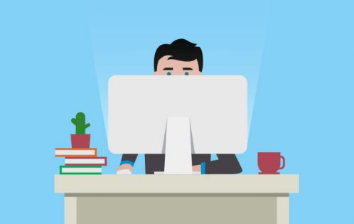 Image of a man sat in front of a computer to show Virtual job seeking and remote interviews