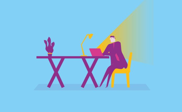 Image of a person sat at a table with laptop and lamp to show Are you omnichannel ready? Required skills for pharma candidates